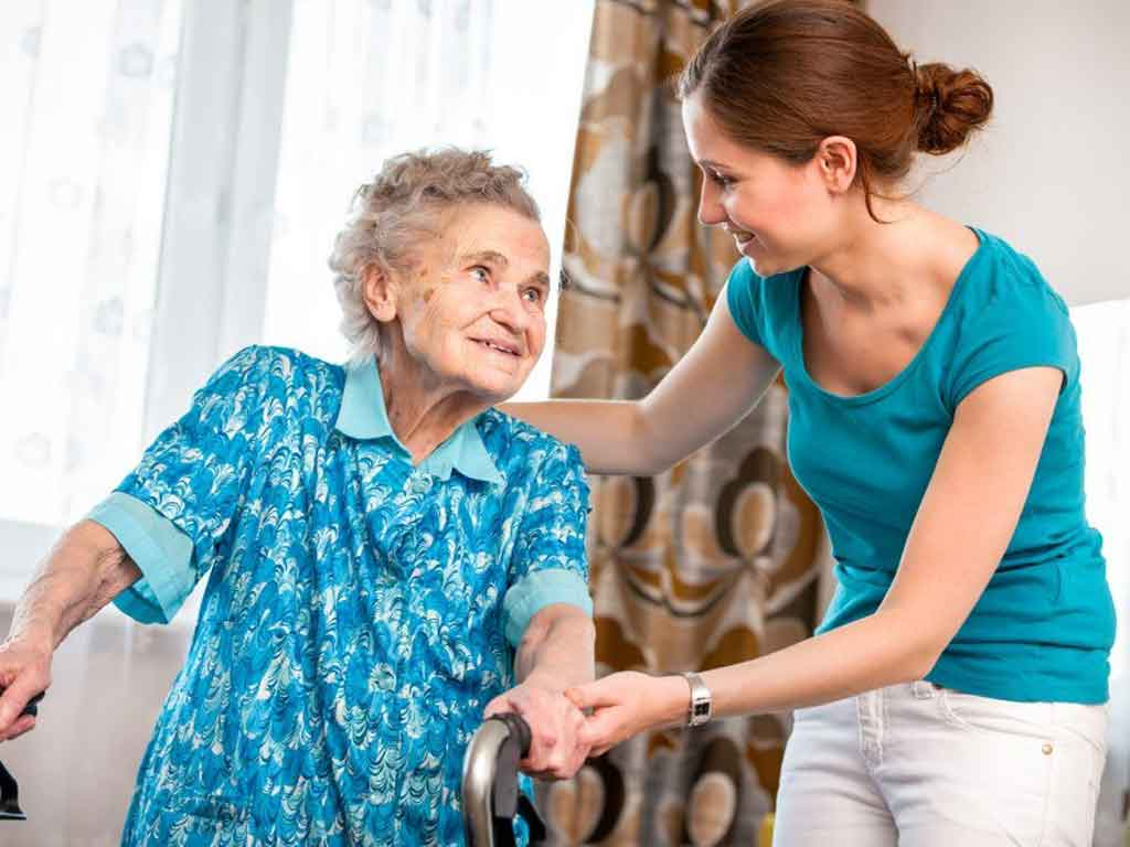 Home Care Services Caregiver Assisting Patient